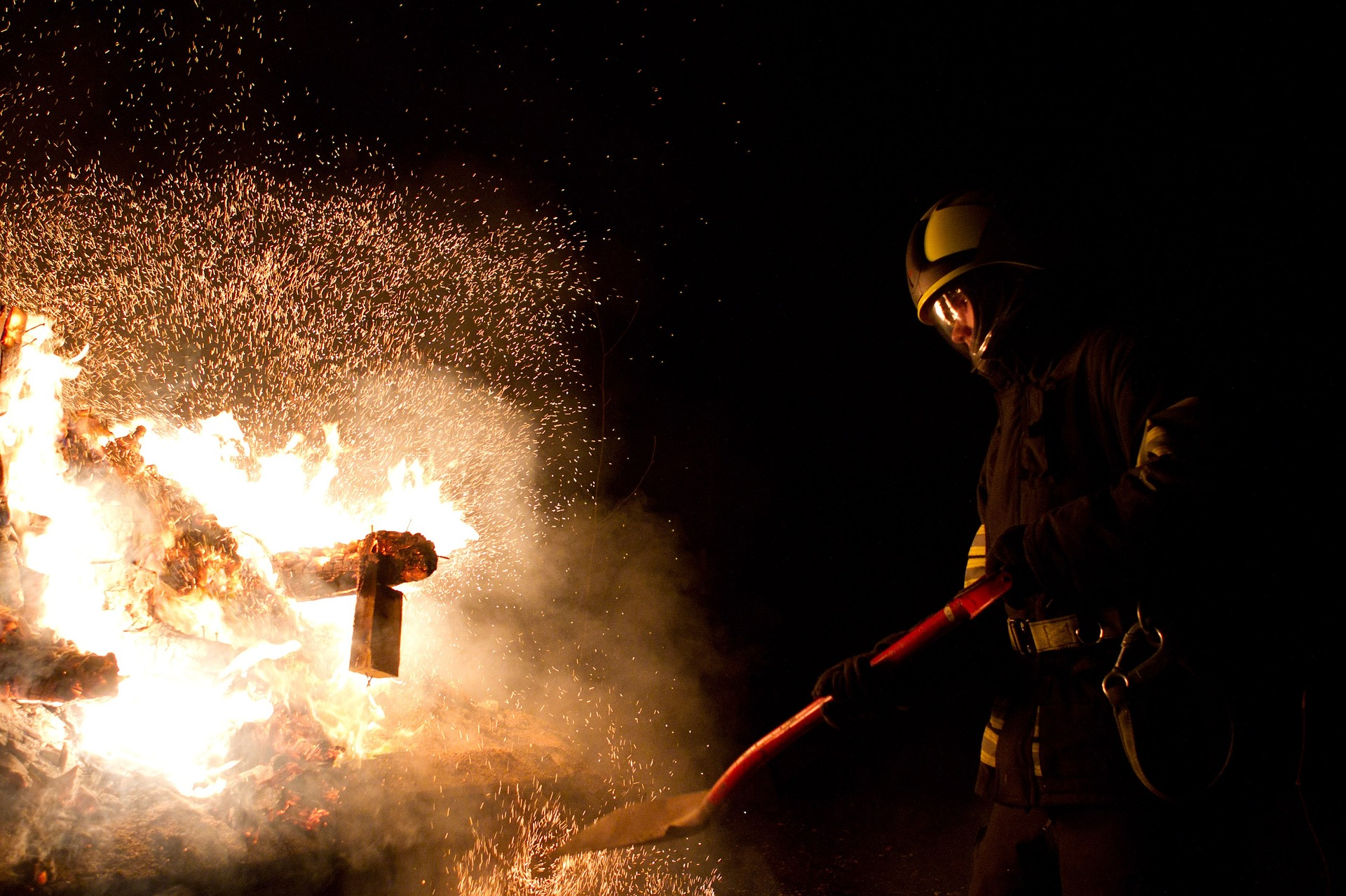 Firefighter tackling a blaze