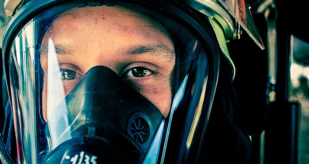 Close up of firefighter in breathing apparatus